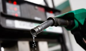 File photo of petrol dripping  from a gasoline pump