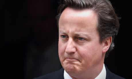 David Cameron leaves Downing Street to debate the phone hacking scandal in Parliament