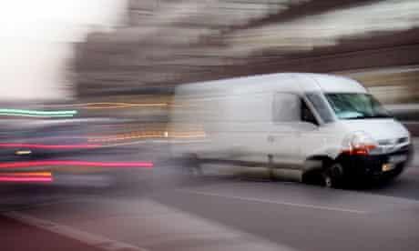 A white van drives through London traffic
