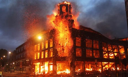 A building burns during rioting in Tottenham