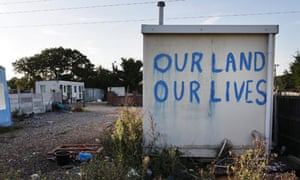 A slogan is painted on a hut at Dale Farm travellers camp