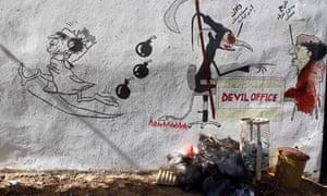 Anti-Gaddafi graffiti and rubbish on the street in Tripoli
