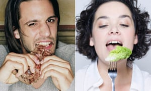 A man eating meat and a woman eating salad