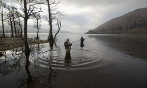 Anglers mark the opening of the salmon fishing season on the River Tay in Kenmore, Scotland