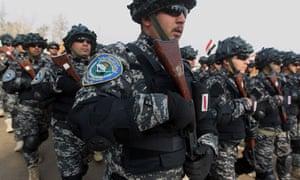 Policemen parade in Baghdad, Iraq