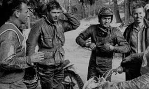 Steve McQueen wears a Belstaff jacket during a motorcycle race in 1963