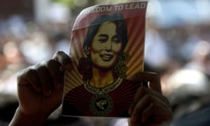 An Aung San Suu Kyi supporter holds up an image of her in Rangoon, Burma