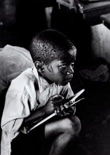 A black schoolboy in a classroom in Apartheid era South Africa