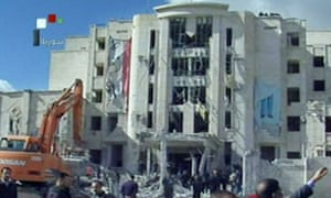 An image from Syrian television shows the scene of a bomb attack in Aleppo