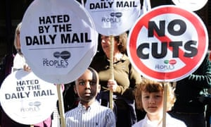 Children hold placards during the protest against the Daily Mail in London
