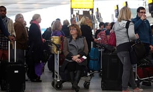 Passengers at Heathrow queue to re-book flights after a technical glitch