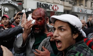 An alleged member of the Muslim Brotherhood is dragged through a crowd of protester in Cairo, Egypt