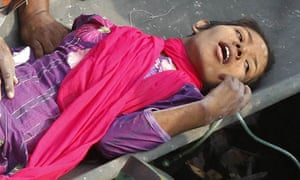 A garment worker called Reshma is rescued from the collapsed Rana Plaza building in Bangladesh