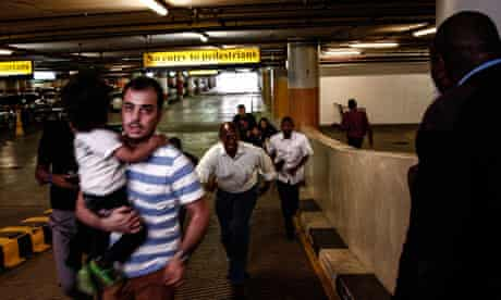 People leaving the Westgate shopping mall in Nairobi after an attack by gunmen
