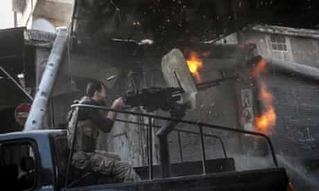 A rebel fighter fires machine gun tin the Jedida district of Aleppo, Syria