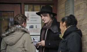 Pete Doherty signs autographs outside the entrance to Gloucester magistrate's court
