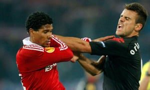 Sa of Fulham scuffles with Lamey of Wisla Krakow during their Europa League soccer match in Krakow