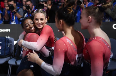 Simone Biles is congratulated by her USA teammates after her floor routine during the Women's Team Finals at the Artistic Gymnastics World Championships on October 08, 2019 in Stuttgart, Germany.