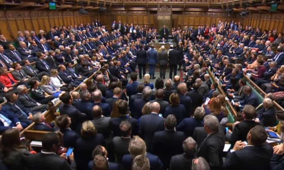 MPs listen for the outcome of a Brexit bill vote in the House of Commons