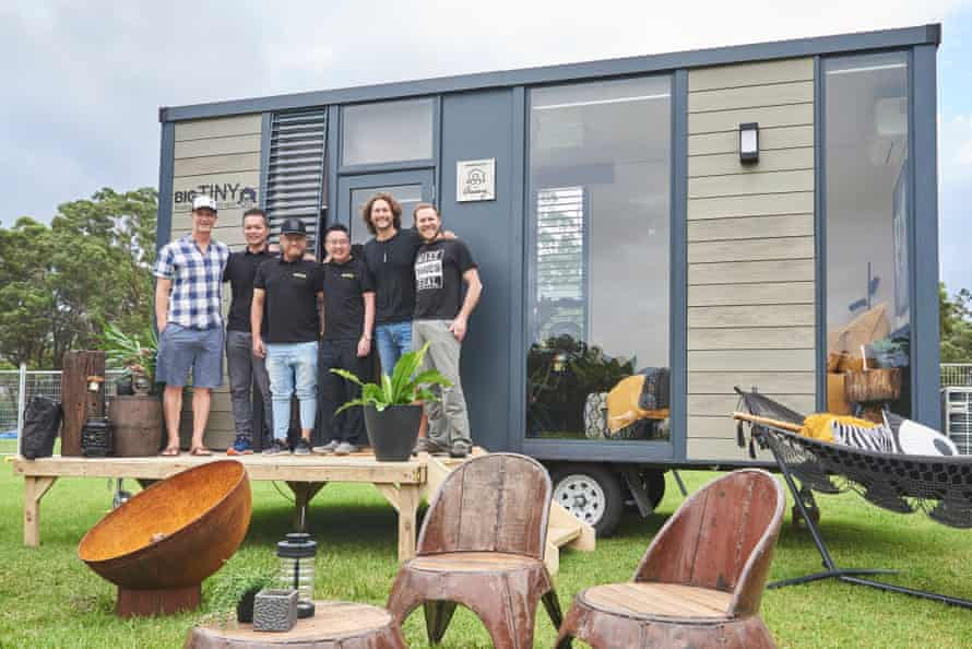 Tiny Homes Carnival guests John Weisbarth, Dave Ng, Jeff Yeo, Adrian Chia, Bryce Langston and Zack Giffin stand in front of one of the houses