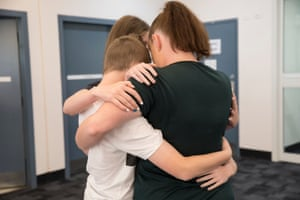 A mother hugs her kids at Dillwynia correctional centre.